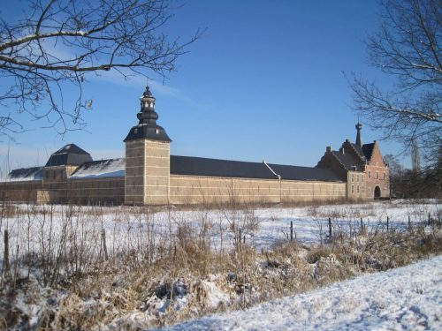 Abbey buildings in a snowy field