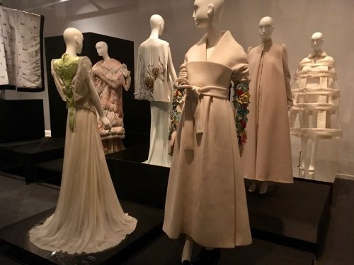 Several mannequins wearing designer dresses